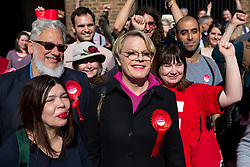 © Licensed to London News Pictures. 03/05/2018. London, UK. Labour activist JON LANSMAN (left), stand up comedian and Labour NEC member EDDIE IZZARD (centre) and Political Director of Unite the Union ANNALIESE MIDGLEY (right) cheer outside Pimlico Tube Station as part of 'Unseat Westminster Tory Council'. The gathering was arranged to round up volunteers to speak to Westminster residents who said they would vote for labour. Photo credit : Tom Nicholson/LNP