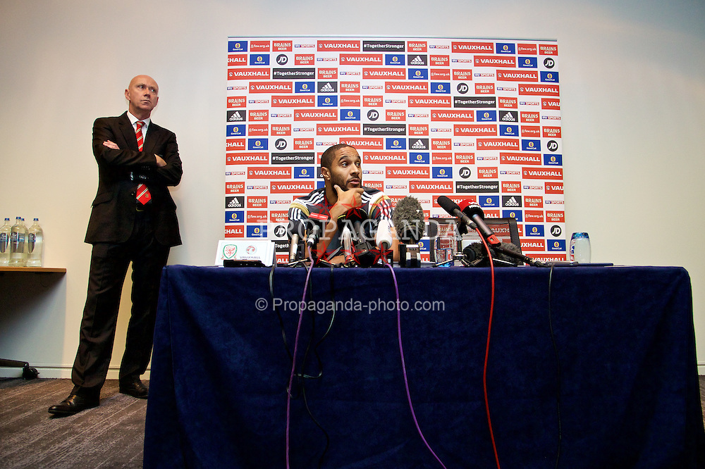 BRUSSELS, BELGIUM - Saturday, November 15, 2014: Wales' captain Ashley Williams and head of pubic affairs Ian Gwyn Hughes during a press conference at the Dolce La Hulpe Hotel ahead of the UEFA Euro 2016 Qualifying Group B game against Belgium. (Pic by David Rawcliffe/Propaganda)