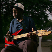 T-Model Ford, Musician, Portrait made as he plays on his front porch in Greenville, Miss.