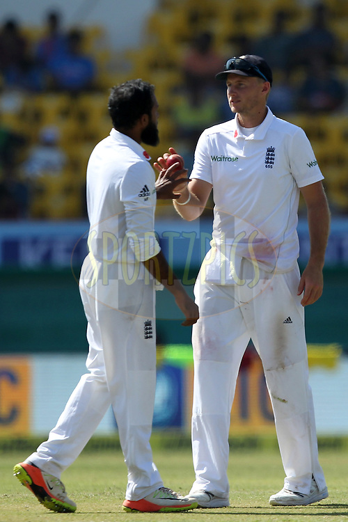 Adil Rashid and Joe Root of England during day 3 of the first test match between India and England held at the Saurashtra Cricket Association Stadium , Rajkot on the 11th November 2016.Photo by: Prashant Bhoot/ BCCI/ SPORTZPICS