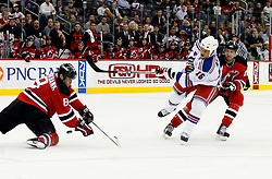 November 14, 2007; Newark, NJ, USA;  New Jersey Devils defenseman Sheldon Brookbank (8) makes a diving stop on a shot by New York Rangers left wing Sean Avery (16) during the first period at the Prudential Center in Newark, NJ.