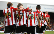 Brentford players join Brentford midfielder Alan Judge to celebrate their second goal during the Sky Bet Championship match between Brentford and Rotherham United at Griffin Park, London, England on 17 October 2015. Photo by Andy Walter.