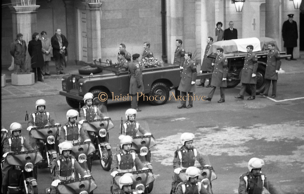 Funeral of President Childers.    (H62)..1974..20.11.1974..11.20.1974..20th November 1974..Following a period of lying in state, the remains of President Erskine Childers were removed today from Dublin Castle. The cortege would transfer the president to St Patrick's Cathedral where the funeral service would be held...Photograph as the pall bearers leave the gun carriage the motorcycle guard of honour prepares to lead the cortege.