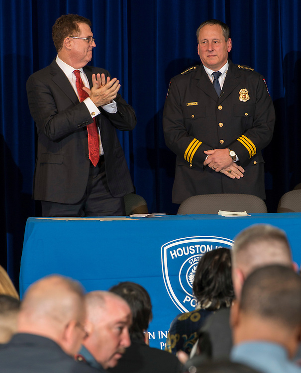 Houston ISD Chief of Police Robert Mock, right, is given an ovation after being sworn into office by superintendent Dr. Terry Grier, left, January 6, 2014, at the High School for Law Enforcement and Criminal Justice.