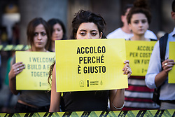 June 20, 2017 - Rome, Italy, Italy - Activists of human rights organization Amnesty International  gather in front of the Pantheon during a Flashmob on World Refugee Day ,in central Rome on June 20 ,2017. Amnesty International call for the protection of refugees ,activate safe channels for asylum seekers and refugees and create an alternative to dangerous irregular crossings  (Credit Image: © Andrea Ronchini/NurPhoto via ZUMA Press)