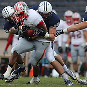 John Spooney, Brown, is tackled during the Yale V Brown, Ivy League Football match at Yale Bowl. Yale won the match 24-17. New Haven, Connecticut, USA. 9th November 2013. Photo Tim Clayton