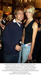 Model JODIE KIDD and TARQUIN SOUTHWELL at a party in London on 8th October 2003.PNJ 55
