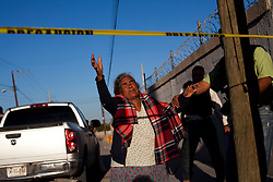A woman cries at a crime scene just after a man was shot and killed in Ciudad Juarez.