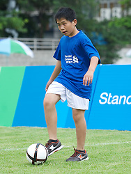 GUANGZHOU, CHINA - Wednesday, July 13, 2011: Visual impared footballers during a Liverpool FC coaching clinic for local youngsters at the Guangzhou Sports University during day three of the club's Asia Tour. (Photo by David Rawcliffe/Propaganda)