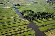 Nederland, Noord-Holland, Schermer, 14-07-2008; Eilandspolder voormalig veeneiland tussen de toenmalige meren Schermer en Beemster; het grillige landschap van de Eilandspolderis ontstan door drainage en vervening (winnen van turf); de Eilandspolder is in gebruik als weide- en hooiland; beschermd natuurgebied voor water- en weidevogels, nat grasland en moeras; watervogelsirregular pattern of drainage in typical Dutch peatland polder. .luchtfoto (toeslag); aerial photo (additional fee required); .foto Siebe Swart / photo Siebe Swart