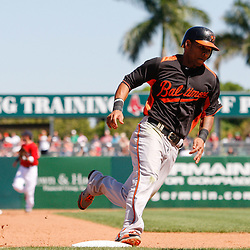 March 7, 2011; Fort Myers, FL, USA; Baltimore Orioles shortstop Robert Andino (11) rounds third base to score a run during a spring training exhibition game against the Boston Red Sox at City of Palms Park.   Mandatory Credit: Derick E. Hingle