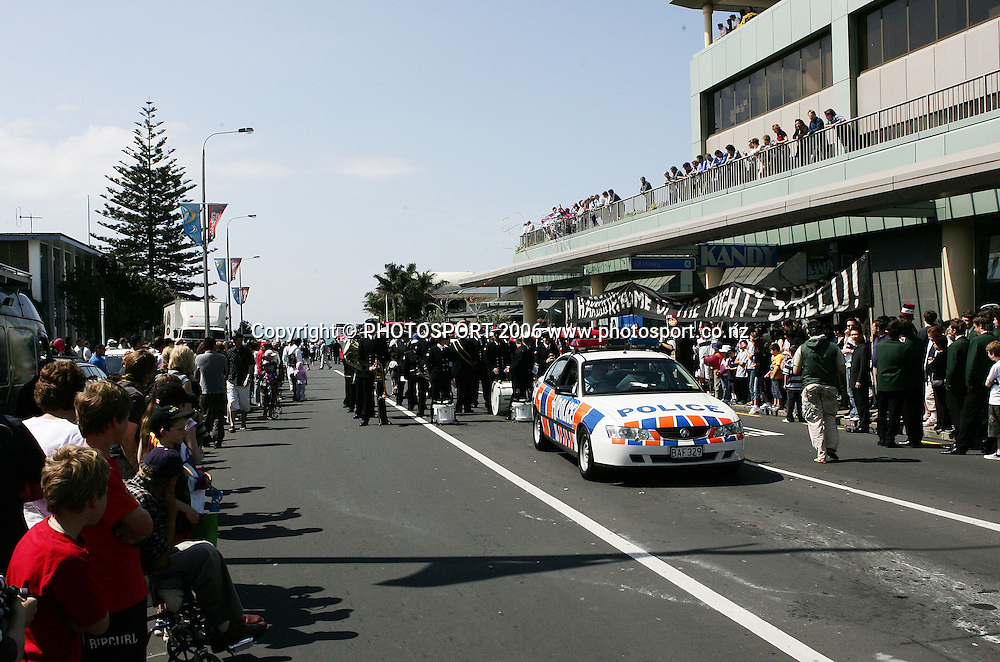 A brass band and police await the beginning of the street parade for the North Habour Air NZ Cup team who won the Ranfurly Shield last weekend, at Takapuna, Auckland, on Thursday 28 September 2006. Photo: Tim Hales/PHOTOSPORT