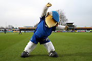 Haydon the Womble doing some stretches prior to kick off during the EFL Sky Bet League 1 match between AFC Wimbledon and Southend United at the Cherry Red Records Stadium, Kingston, England on 1 January 2020.