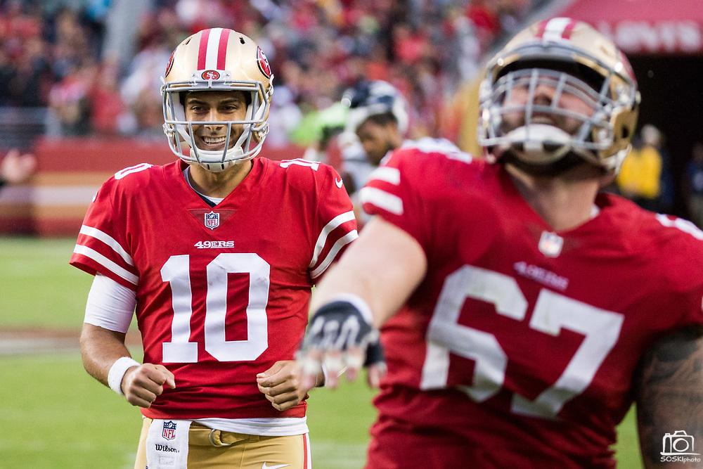 San Francisco 49ers quarterback Jimmy Garoppolo (10) celebrates a touchdown pass against the Seattle Seahawks at Levi's Stadium in Santa Clara, Calif., on November 26, 2017. (Stan Olszewski/Special to S.F. Examiner)