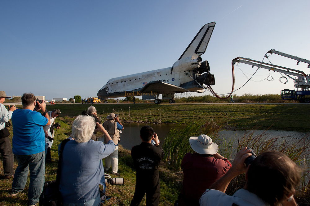 Space shuttle Discovery is towed from the Shuttle Landing Facility to the Orbiter Processing Facility for a final time at Kennedy Space Center in Florida on Wednesday, March 9, 2011.