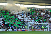 Plymouth fans hold up green and white banners and let off a smoke bomb  before kick-off in the Sky Bet League 2 play off first leg match between Plymouth Argyle and Portsmouth at Home Park, Plymouth, England on 15 May 2016. Photo by Graham Hunt.
