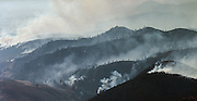 The hills of the Methow near Winthrop and Twisp are filled with wildfire and smoke in central Washington as seen from a helicopter Thursday August 20, 2015.<br />