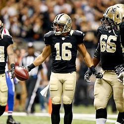 Oct 27, 2013; New Orleans, LA, USA; New Orleans Saints wide receiver Lance Moore (16) celebrates after a touchdown during the first quarter of a game at Mercedes-Benz Superdome. Mandatory Credit: Derick E. Hingle-USA TODAY Sports