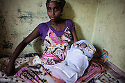 A 15 years old prostitute, with her child born to a few days. As a result of abuse suffered by a client she got pregnant with twins, one died a few hours after birth.<br /> <br /> Addis Ababa, Ethiopia, 09-03-2013.<br /> <br /> To protect the identities of the recorded subjects names are omitted