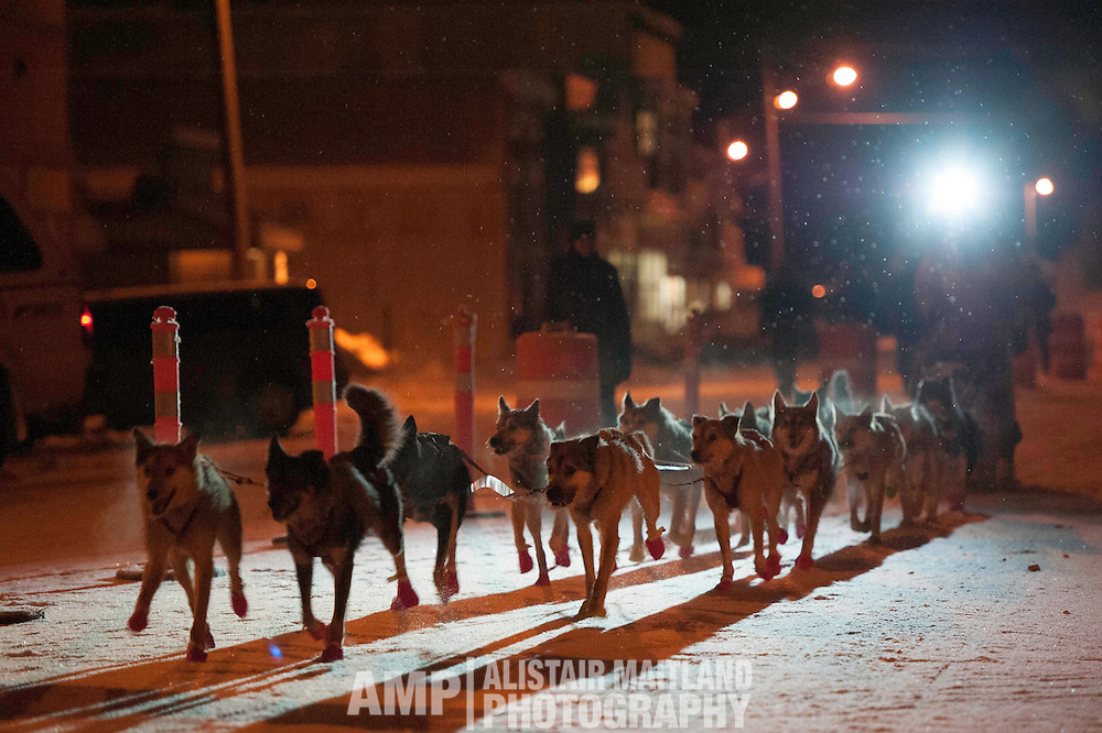 Jake Berkowitz enters Dawson City Checkpoint, the third musher of the Yukon Quest to do so.