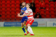 AFC Wimbledon defender Callum Kennedy (23) waits for the ball with Doncaster Rovers forward John Marquis (9)  during the EFL Sky Bet League 1 match between Doncaster Rovers and AFC Wimbledon at the Keepmoat Stadium, Doncaster, England on 1 May 2018. Picture by Simon Davies.