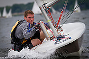 A Laser sailor grips onto the centerboard during a downwind leg of the 2011 Midwest Junior Olympics out of Wayzata Yacht Club in Wayzata, Minnesota on Saturday.
