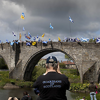 BRAVEHEART HEROES, WILLIAM WALLACE AND ANDREW DE MORAY, FINALLY HONOURED AT STIRLING BRIDGE BATTLE SITE AS SALTIRE RAISED FOR FIRST TIME IN OVER 700 YEARS<br /> <br /> Friday 29th May, 2015<br /> <br /> IT&rsquo;S TAKEN more than 700 years but today, the two heroes at the centre of one of the most important battles in Scottish history have been jointly honoured at the spot where they both led an outnumbered Scottish army to victory against the English.<br /> The formal unveiling ceremony at Stirling Bridge today (Friday 29th May), of three lecterns made of traditional Scottish whinstone dedicated to the memory of William Wallace and Andrew de Moray,&nbsp;at site of the historic victory at Battle of Stirling Bridge.<br /> At a special ceremony attended by Andrew de Moray&rsquo;s direct descendant, the Earl of Moray, and Stewart Maxwell, MSP, convener of the Scottish Parliament&rsquo;s Education and Culture Committee, the memorials were formally unveiled.Mr Maxwell opened the event and after the dedication, together with the Earl of Moray, they raised the Saltire together at the site of the Battle of Stirling Bridge. This is the first time in over 700 years that the Saltire has flown at Stirling Bridge. The flag will now become a permanent fixture at the site of the Battle.<br /> John Stuart, the current Earl of Moray, said of his illustrious kinsman: &ldquo;I am delighted that Andrew de Moray is finally, after 700 years, to have the recognition he deserves. The Guardians of Scotland have put a huge amount of time and effort into the lecterns, which are a very fitting tribute to one of Scotland's greatest patriots.&quot;<br /> The victory represented a key moment in the Scottish Wars of Independence. Eminent Scots historian, Sir Tom Devine, recently described the battle as being &lsquo;second in importance only to Bannockburn in the Wars of Independence&rsquo;.&nbsp;<br /> It is the first time the two men have been given equal prominence. One stone tells the story of Andrew de Moray while another describes Wallace&rsquo;s role. A third lectern the story of the