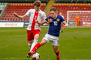 Kai Kennedy (Rangers FC) tries to get away fromNikodem Niski during the U17 European Championships match between Scotland and Poland at Firhill Stadium, Maryhill, Scotland on 26 March 2019.