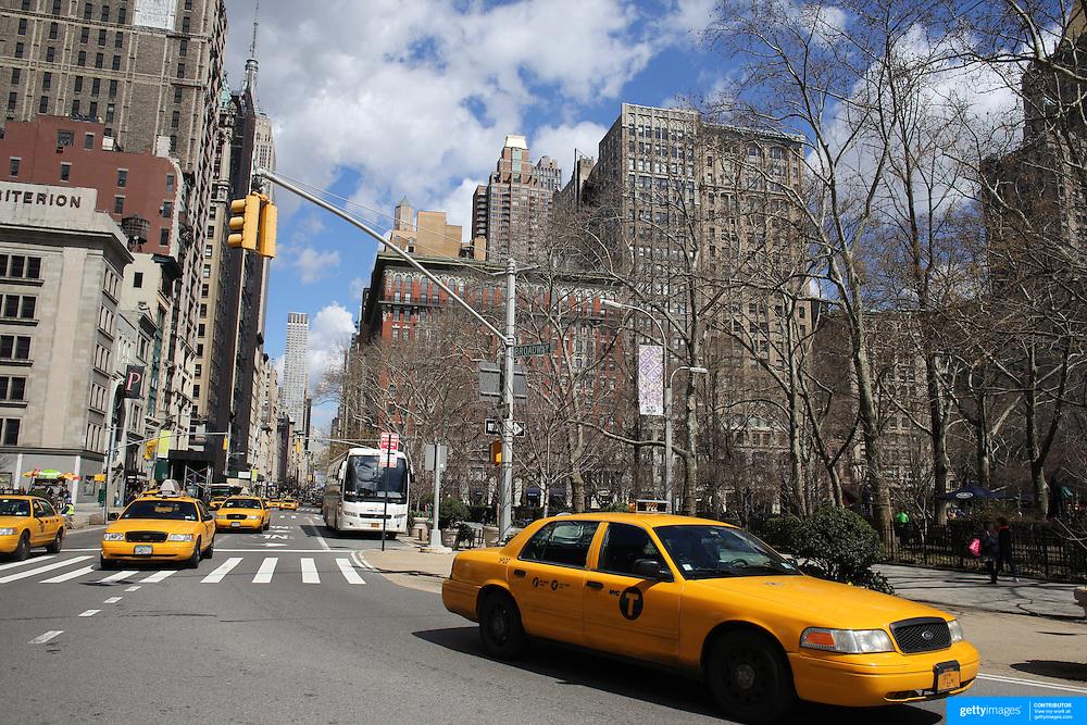 A Manhattan street scene showing yellow taxi cabs. Manhattan, New York, USA. 26th March 2013. Photo Tim Clayton