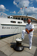 "The luxurious river cruise ship River Cloud of Sea Cloud Cruises visits Vienna..Captain Harry Ripson in front of ""his"" boat."