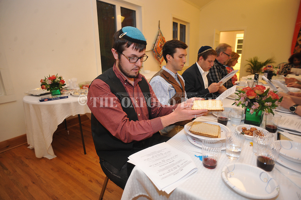 Connor Somgynari (left) says the blessing as the Oxford Jewish community held a Community Seder, in Oxford, Miss. on Monday, April 14, 2014.