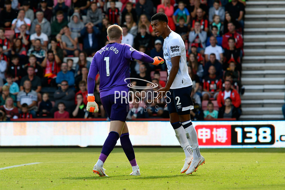 Mason Holgate (2) of Everton looks upset with Jordan Pickford (1) of Everton during the Premier League match between Bournemouth and Everton at the Vitality Stadium, Bournemouth, England on 25 August 2018.