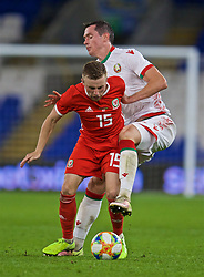 CARDIFF, WALES - Monday, September 9, 2019: Wales' Joseff Morrell is challenged bt Belarus' Mikalai Sihnevich during the International Friendly match between Wales and Belarus at the Cardiff City Stadium. (Pic by David Rawcliffe/Propaganda)