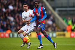 Dejan Lovren of Liverpool and Emmanuel Adebayor of Crystal Palace on the ball - Mandatory byline: Jason Brown/JMP - 07966386802 - 06/03/2016 - FOOTBALL - London - Selhurst Park - Crystal Palace v Liverpool - Barclays Premier League