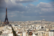 Overlooking Paris (with the Eiffel Tower off to the left) across the Seine looking towards The Basilica of the Sacred Heart of Paris, which is commonly known as Sacré-Cœur Basilica. It is a Roman Catholic church and minor basilica, dedicated to the Sacred Heart of Jesus, in Paris, France.