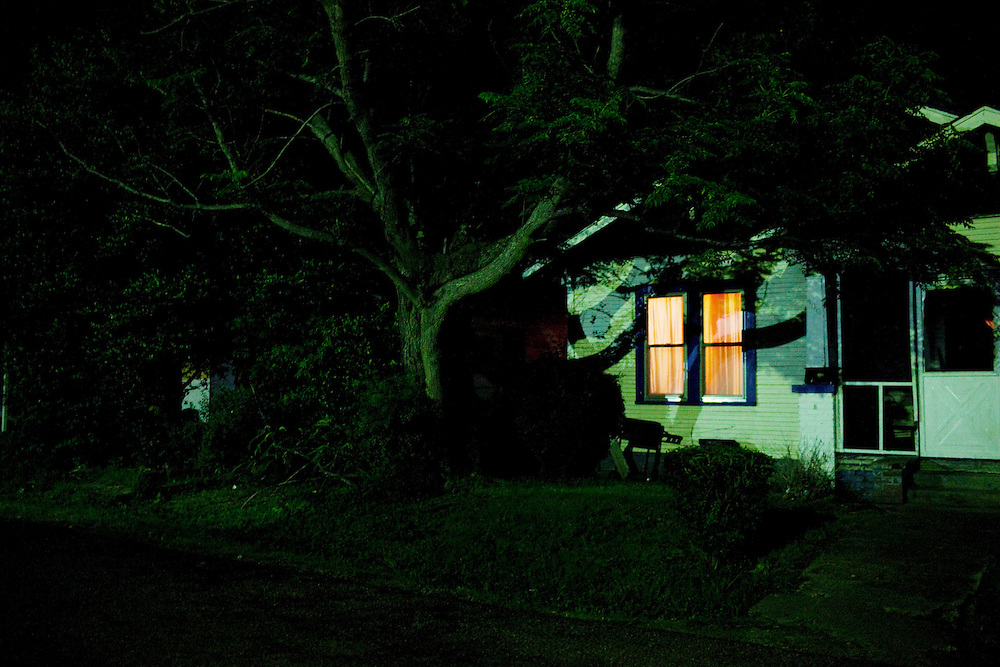 The home shared by Ellen Wilson and her son Jabari glows in the night in the Baptist Town neighborhood of Greenwood, Mississippi on May 26, 2011.