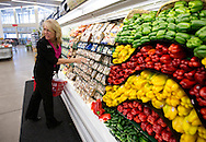 Dietitian Dawn Blocklinger talks about options in the produce section at a Hy-Vee store in Moline, Illinois on Tuesday August 7, 2012.