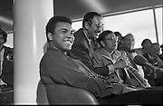 Muhammad Ali In Dublin..1972..11.07.1972..07.11.1972..11th July 1972..Prior to his fight against Al 'Blue' Lewis at Croke Park ,Dublin, former World Heavyweight Champion,Muhammad Ali arrives at Dublin Airport..The fight was part of his build up for for a championship fight against the current World Champion, 'Smokin'  Joe Frazier. Ali had been stripped of the title partly due to his refusal to join the American military during The Vietnam War,which he had opposed...Image of a very relaxed Muhammad Ali as Angelo Dundee takes questions.