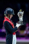 Charlotte Dujardin, winner Reem Acra FEI World Cup Final <br /> FEI World Cup Final 2014<br /> © DigiShots