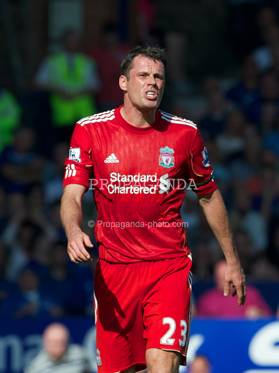 LIVERPOOL, ENGLAND - Saturday, October 1, 2011: Liverpool's Jamie Carragher in action against Everton during the Premiership match at Goodison Park. (Pic by David Rawcliffe/Propaganda)