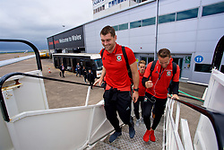 CARDIFF, WALES - Saturday, June 10, 2017: Wales' Sam Vokes and Chris Gunter board the team plane as the squad depart Cardiff Tesla Airport to travel to Belgrade ahead of the 2018 FIFA World Cup Qualifying Group D match against Serbia. (Pic by David Rawcliffe/Propaganda)