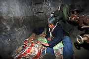 "BEIJING, CHINA - DECEMBER 05: China Out - Finland Out<br /> <br /> Living Underground<br /> <br /> Garbage collector Quan Youzhi, 66, from Henan province, talks to journalists inside an underground utility compartment outside Lidu Park in Chaoyang district on December 5, 2013 in Beijing, China. Four people have been living in some of the compartments there for at least two years, said security guard Wei Zhonghua. ""They usually come to the park to use the restroom around 8 am, and return quite late in the evening. Sometimes they charge their flashlights in the security guard's room,"" he said. <br /> ©Exclusivepix"