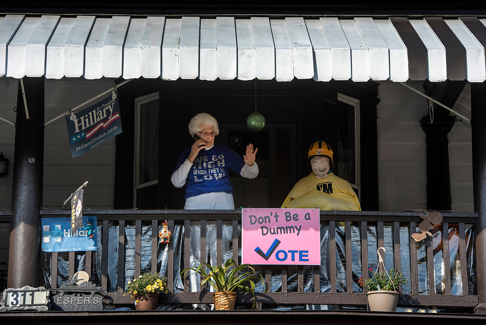 Homestead Betty Esper talks with her niece on her flip phone on Election Day 2016 at her Homestead home. Esper, an ardent Hillary Clinton supporter, has lived in the house since 1951. She decorated her porch to encourage others to vote.