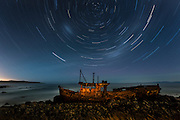 1 hour 14 second exposure of stars rotating around the Southern Polaris point, above a shipwreck which has been painted by light for approximately 3 minutes.