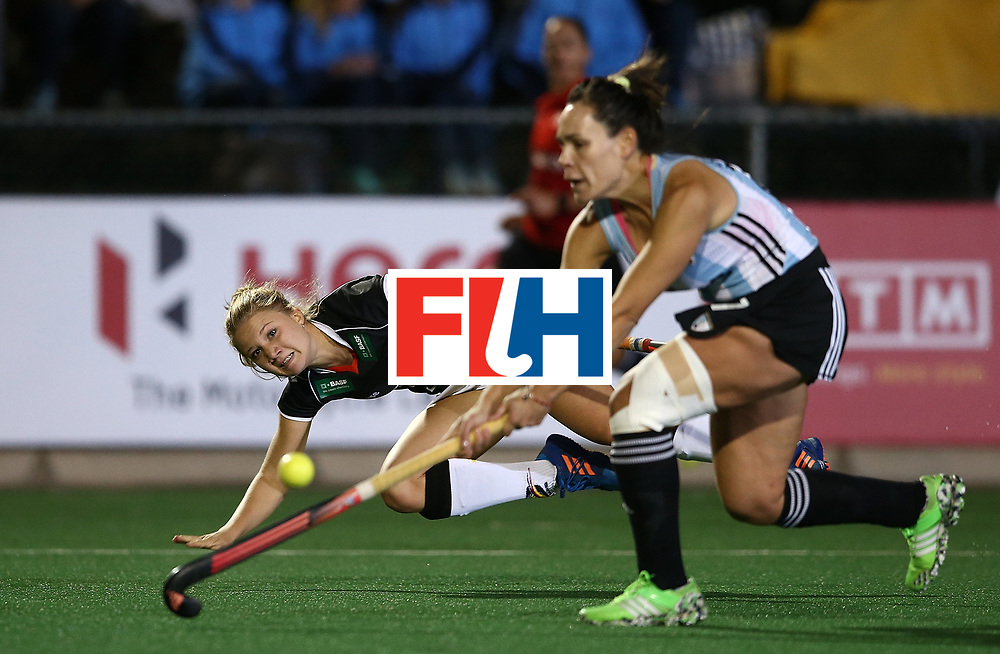 JOHANNESBURG, SOUTH AFRICA - JULY 20:  Camille Nobis of Germany takes a shot at goal under pressure from Noel Barrionuevo of Argentina during day 7 of the FIH Hockey World League Women's Semi Finals semi final match between Germany and Argentina at Wits University on July 20, 2017 in Johannesburg, South Africa.  (Photo by Jan Kruger/Getty Images for FIH)