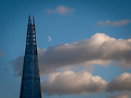 Moon rising over The Shard Building, London, Britain