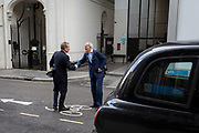 Two businessmen shake hands after meeting in a side street in the capital's financial district, on 5th October, 2017, in the City of London, England.