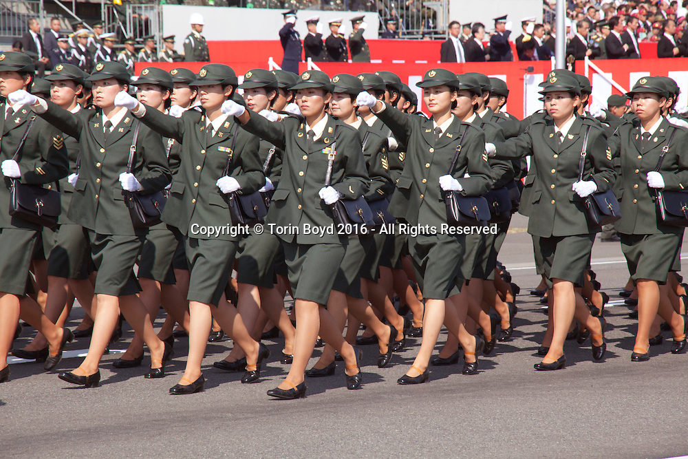October, 23, 2016, Asaka, Saitama Prefecture, Japan: Female soldiers of the Japan Ground Self Defense Force march in formation during the annual military review held at the Asaka Training Area, a Japan Ground Self Defense Force (JSDF) base on the outskirts of Tokyo. For this event, Prime Minister Shinzo Abe, top ranking Japanese brass and international dignitaries were in attendance to view Japan's military might. This included 4000 troops, 27 divisions, 280 vehicles and artillery, plus 50 aircraft of the Ground, Air, and Maritime branches of the JSDF. (Torin Boyd/Polaris).