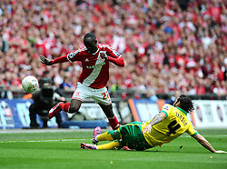 Norwich City's Bradley Johnson tackles Middlesbrough's Albert Adomah  - Photo mandatory by-line: Joe Meredith/JMP - Mobile: 07966 386802 - 25/05/2015 - SPORT - Football - London - Wembley Stadium - Middlesbrough v Norwich - Sky Bet Championship - Play-Off Final