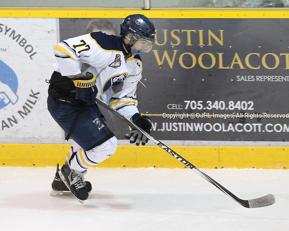LINDSAY, ON - Oct 16, 2015 : Ontario Junior Hockey League game action between Buffalo and Lindsay. Michael Benaquist Jr. #77 of the Buffalo Junior Sabres skates with the puck during the first period.<br /> (Photo by Tim Bates / OJHL Images)